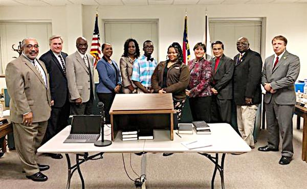 County Commissioners with jr. members, Dr. Edmonds and 3 BOE members