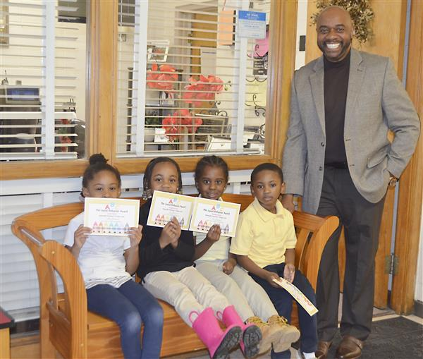 Preschool students receive awards from Dr. Smallwood
