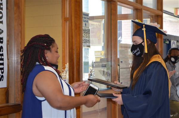 Student received MCC diploma from the college liaison for BECHS