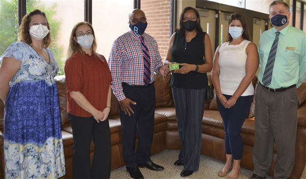 ECU Dental group presents gift cards to superintendent and director of student services