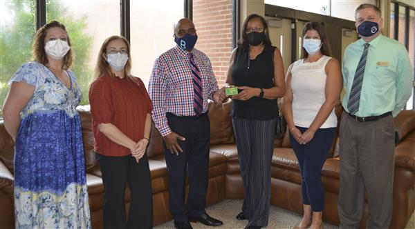 Dental group from ECU presents gift cards to Superintendent and Director of Student Services