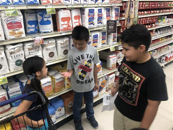 Students practice unit pricing at local Food Lion
