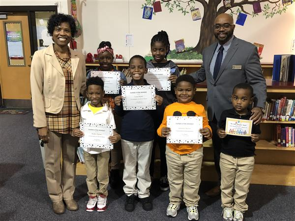 Super Star Students for September with Dr. Smallwood and Colerain Principal