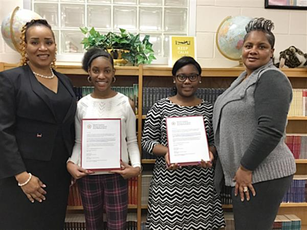 Two students chosen to attend, pictured with principal and Beta Club Advisor