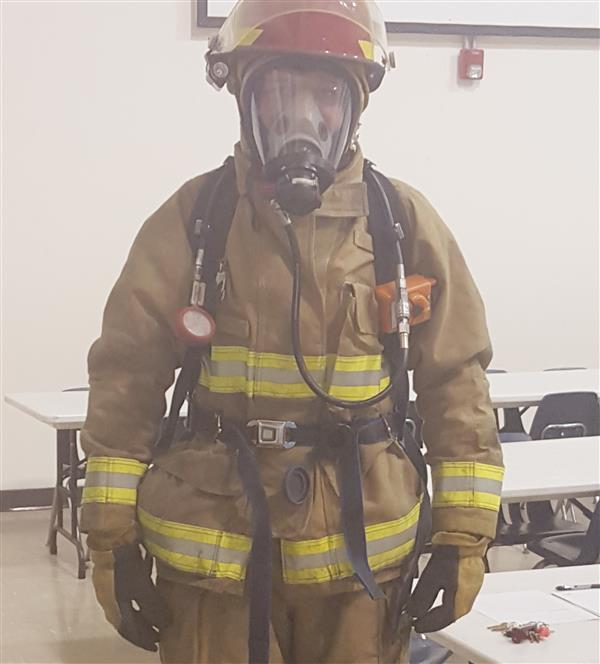 Firefighter in full uniform