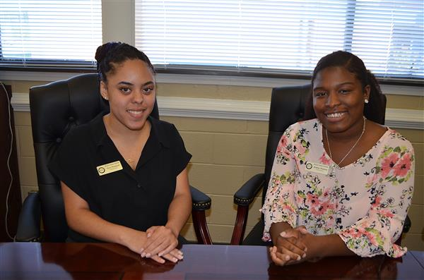 Tyra Woolard and Justine Walston at conference table