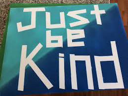 green and blue 'just be kind' sign