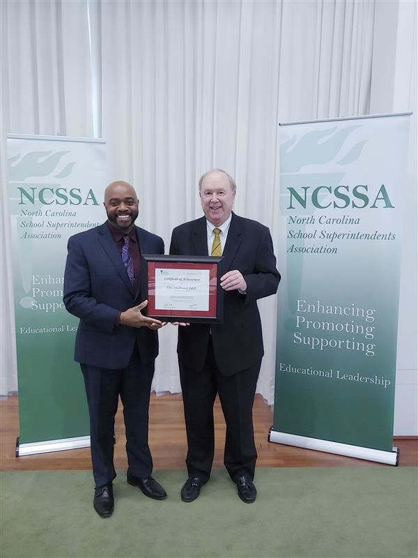 Dr. Smallwood receives his certificate of completion