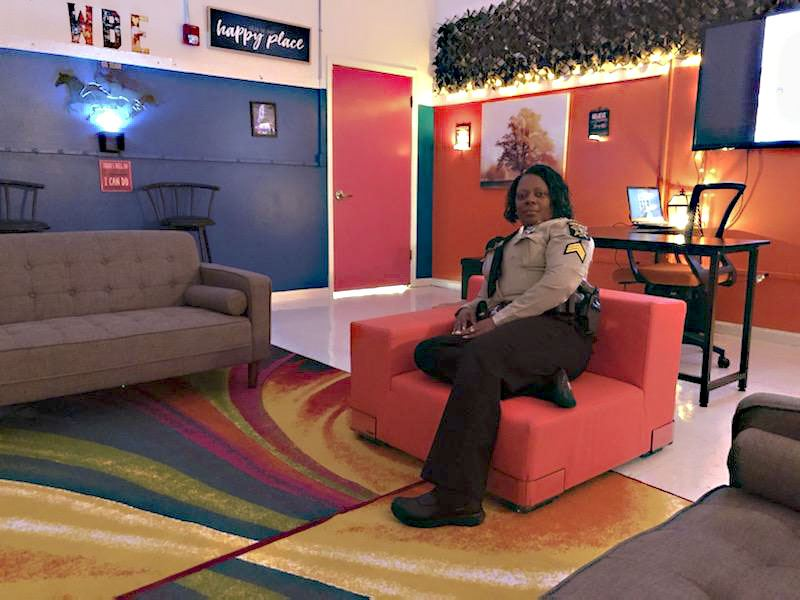 Sgt. Powell relaxes on a sofa in the Comfort Zone room