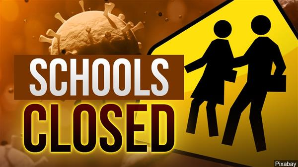 Schools closed with school crossing sign and coronavirus art